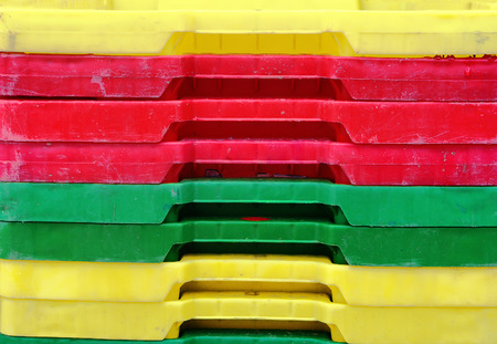 fishery products: colorful plastic containers stack for fish Stock Photo