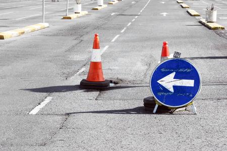 pot hole: Road detour sign and cones due a pothole