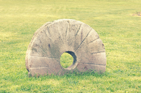 millstone: old millstone with vintage effect