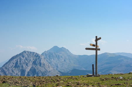wooden signpost in the mountain