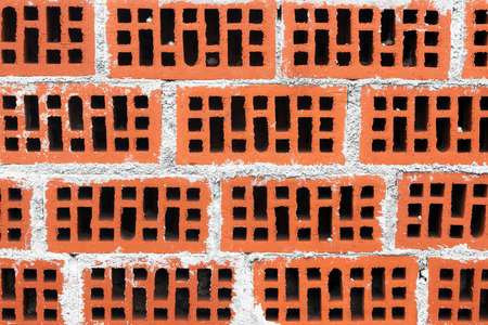background of wall of red bricks with cement photo