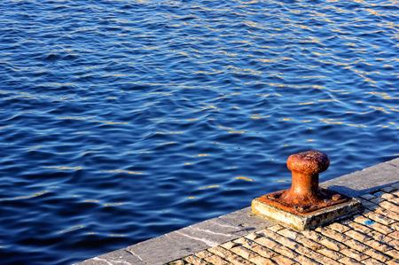 bollard: rusty bollard on port water Stock Photo