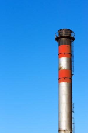 smokestack: metallic smokestack against blue sky