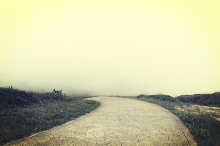 nowhere: road to nowhere with fog and vintage filter effect Stock Photo