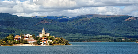 alava: Ullibarri Gamboa village surrounding by reservoir, in Alava, Basque Country