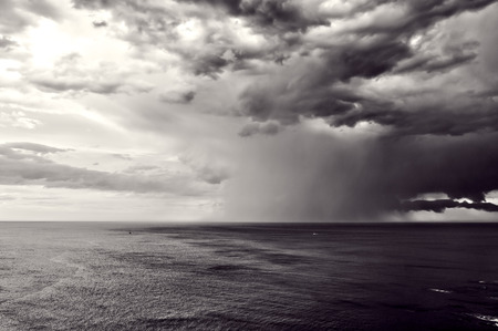 downpour: downpour over sea with stormy clouds