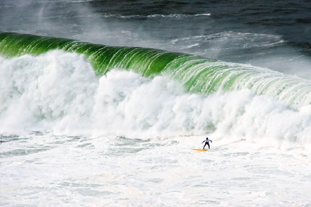 cantabrian: surfer under big wave. Getxo Stock Photo