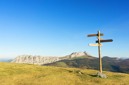 signpost with view of Anboto mountain range. Urkiola