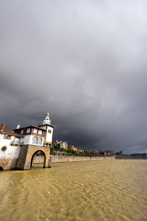 seafront: Getxo seafront and the Arriluze lighthouse with stormy weather