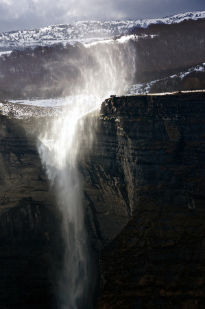 alava: Nervion river source and waterfall with windy weather Stock Photo