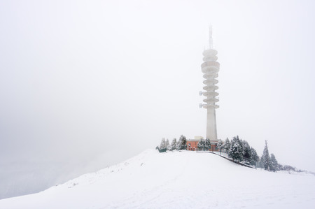 repeater: snowy telecommunications tower repeater in winter Stock Photo