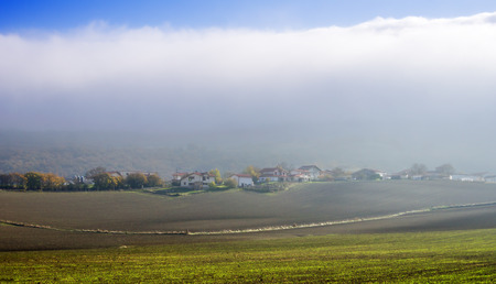 alava: Opakua village with fog. Alava, Basque Country Stock Photo