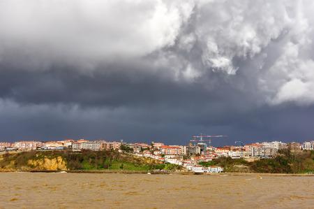 viejo: Puerto Viejo of Algorta with stormy clouds. Getxo