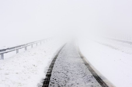 space weather tire: road in winter with snow and car track