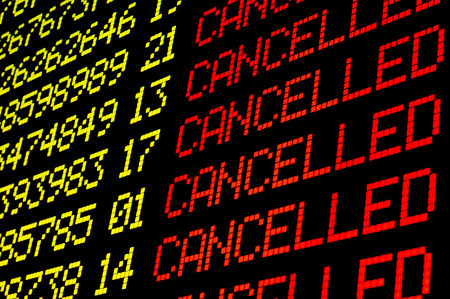 Cancelled flights on airport board panel