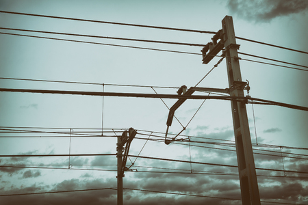 train cable catenary and poles with vintage filter effect