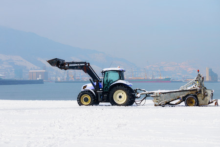 tractor machine cleaning snow Stock Photo