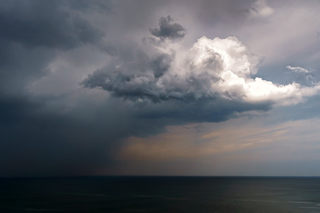 rain and stormy cloud over the sea