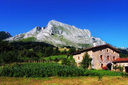 Basque farmhouse under Anboto mountain in Arrazola. Basque Country
