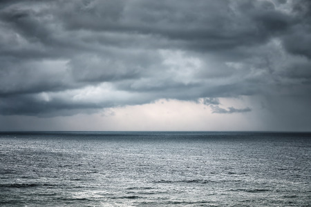 rain and stormy cloud on the sea Stockfoto