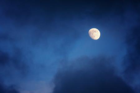 waxing gibbous moon on a cloudy sky Foto de archivo