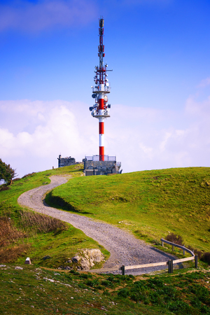 telecommunications tower on mountain top on sunny day Stock Photo