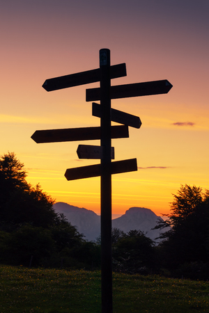 signpost in the mountain. Multiple choice Stock Photo