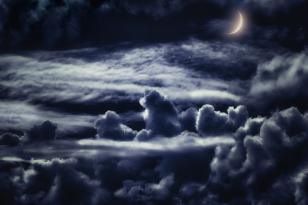 dreamy cloudscape at night with moonlight