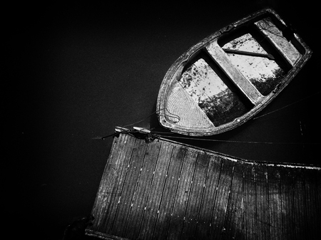 old boat moored on dock. Noise added