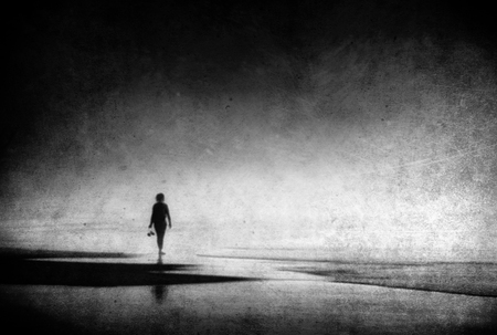 lonely woman walking on beach with grungy textures Stok Fotoğraf