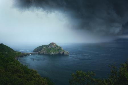 San juan de gaztelugatxe with stormy clouds