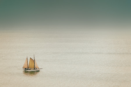 old and antique sailboat with vintage effect on the sea