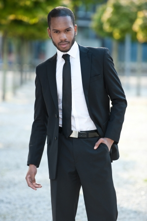 african businessman: Handsome man in a suit outside Stock Photo