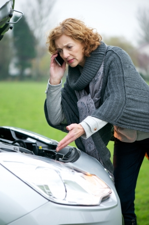 Female driver needed help as her car has borken down on the side of the road. She is calling and speaking to technical support in search of assistance with engine trouble.