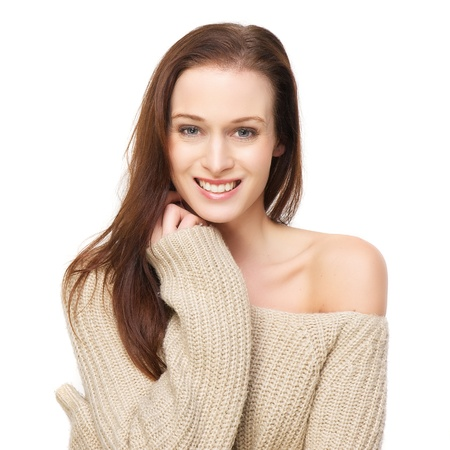 Close up portrait of a beautiful young woman with a cute smile, isolated on white background