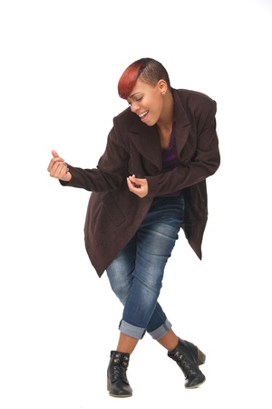 Young African American female dancer snapping her fingers in a dance pose. Isolated on white background