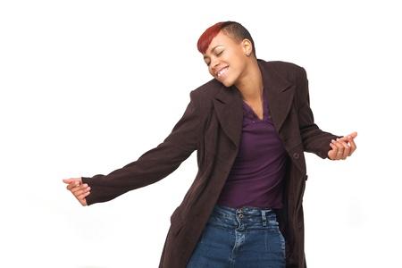 danza africana: Horizontal retrato de una hermosa mujer afroamericana joven en actitud de la danza. Aislado sobre fondo blanco Foto de archivo