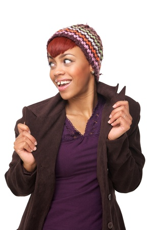 Portrait of a young African American woman holding her jacket and looking to the side. Isolated on white background photo