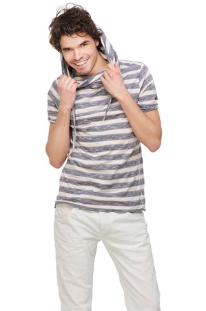 hooded sweatshirt: Young handsome man smiling and isolated on white background, holding his hooded sweatshirt