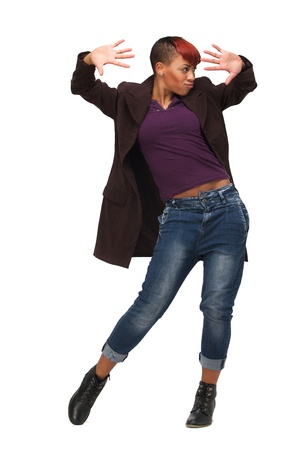 Beautiful African American woman in modern dance pose. Isolated on white background photo