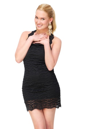 embarrassed: Beautiful young female wearing cute black dress. She is smiling and isolated on white background