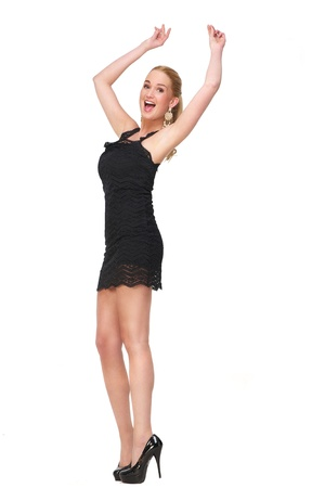 Cute female snapping her fingers and with her arms up dancing. She has her arms up and a happy expression on her beautiful face. Full length portrait isolated on white background photo