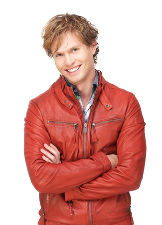 Attractive male fashion model wearing a red leather jacket looking at camera and with a smile expression on his face. Isolated on white background photo