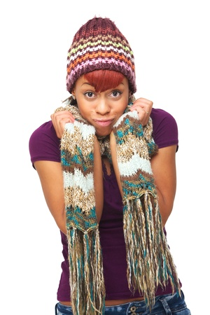 Young African American woman holding her scarf and with a funny expression on her face. Isolated on white background Stock Photo - 17188725