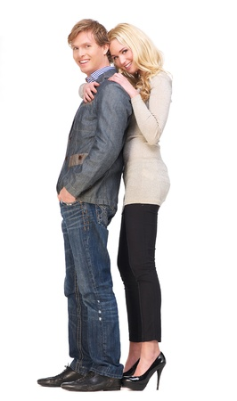Full body portrait of a happy couple with a smile on their face. Beautiful girlfriend leans on her boyfriend's shoulder. Isolated on white background photo