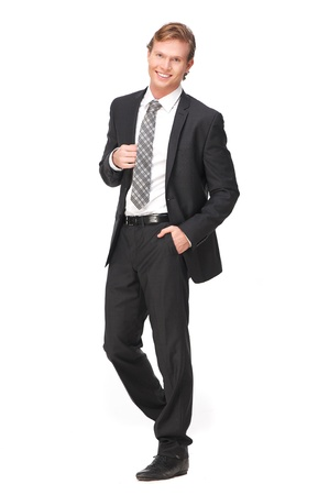 copyspace corporate: Attractive businessman with a smile on his face. Full length portrait of handsome business person holding his jacket. Isolated on white background Stock Photo