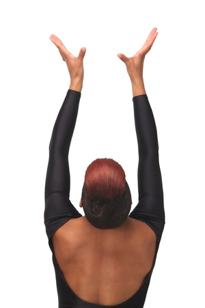 Spiritual portrait of an African American woman with hands up to the heavens. meditation and serenity in an elegant pose from behind. Isolated on white background photo