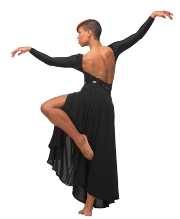 African American woman standing on one leg with arms up