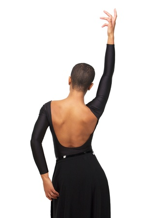 dance pose: Portrait of an African American woman with hand up - from behind