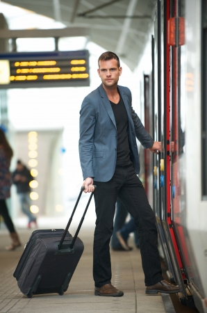leaving: Young businessman traveling with bag at subway station Stock Photo